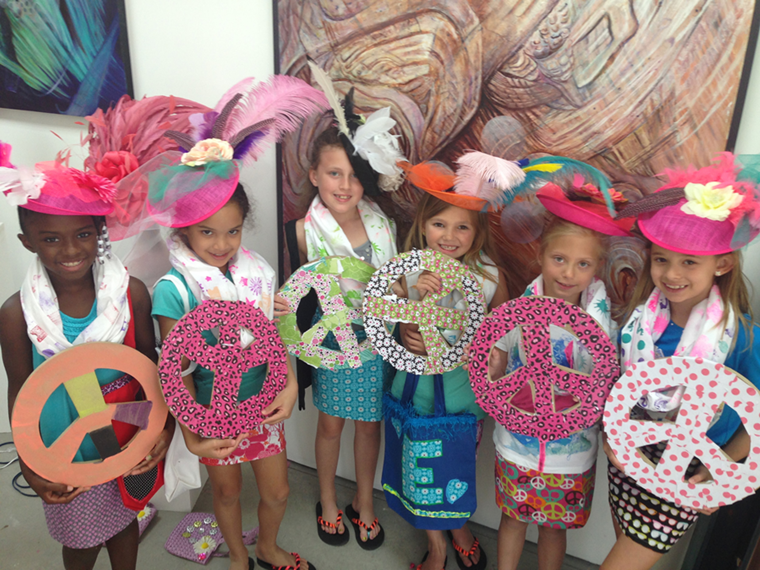 girls wearing derby hats and showing peace sign creations