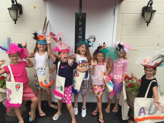 girls wearing derby hats the mill