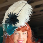 navy feathers Derby hat